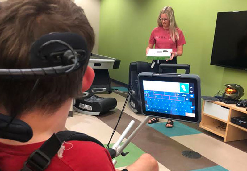 Anne Carlsen client using assistive technology in classroom