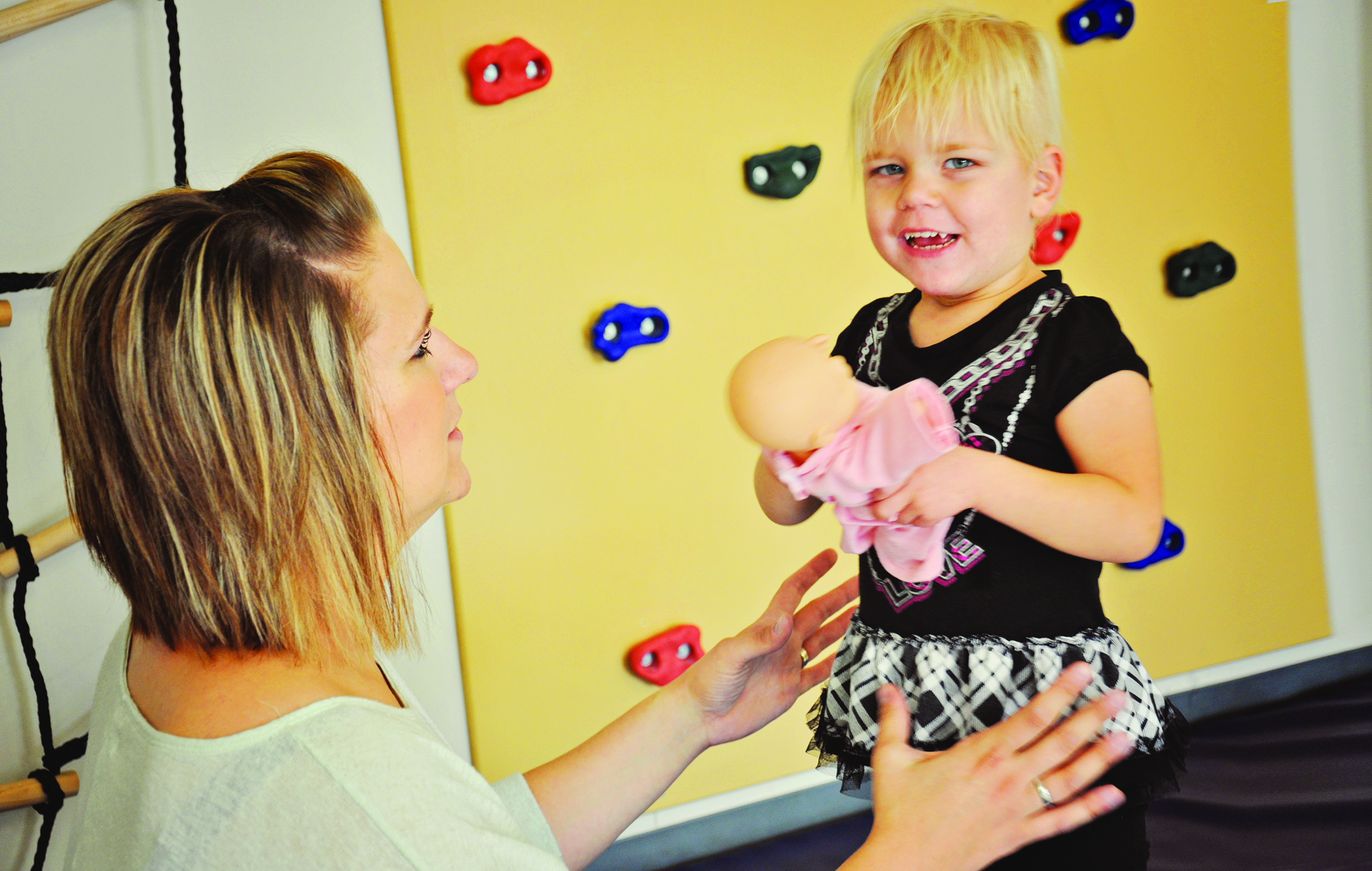 Young child working with Physical Therapist at Anne Carlsen